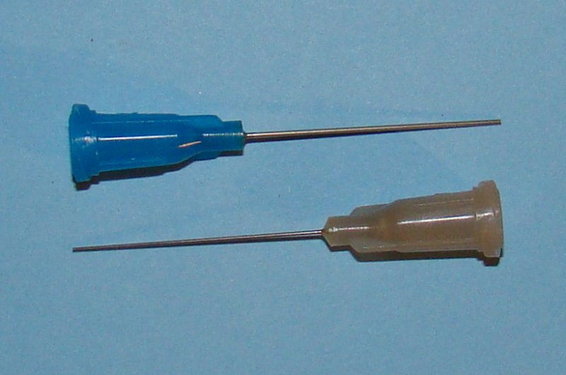 Needle applicators